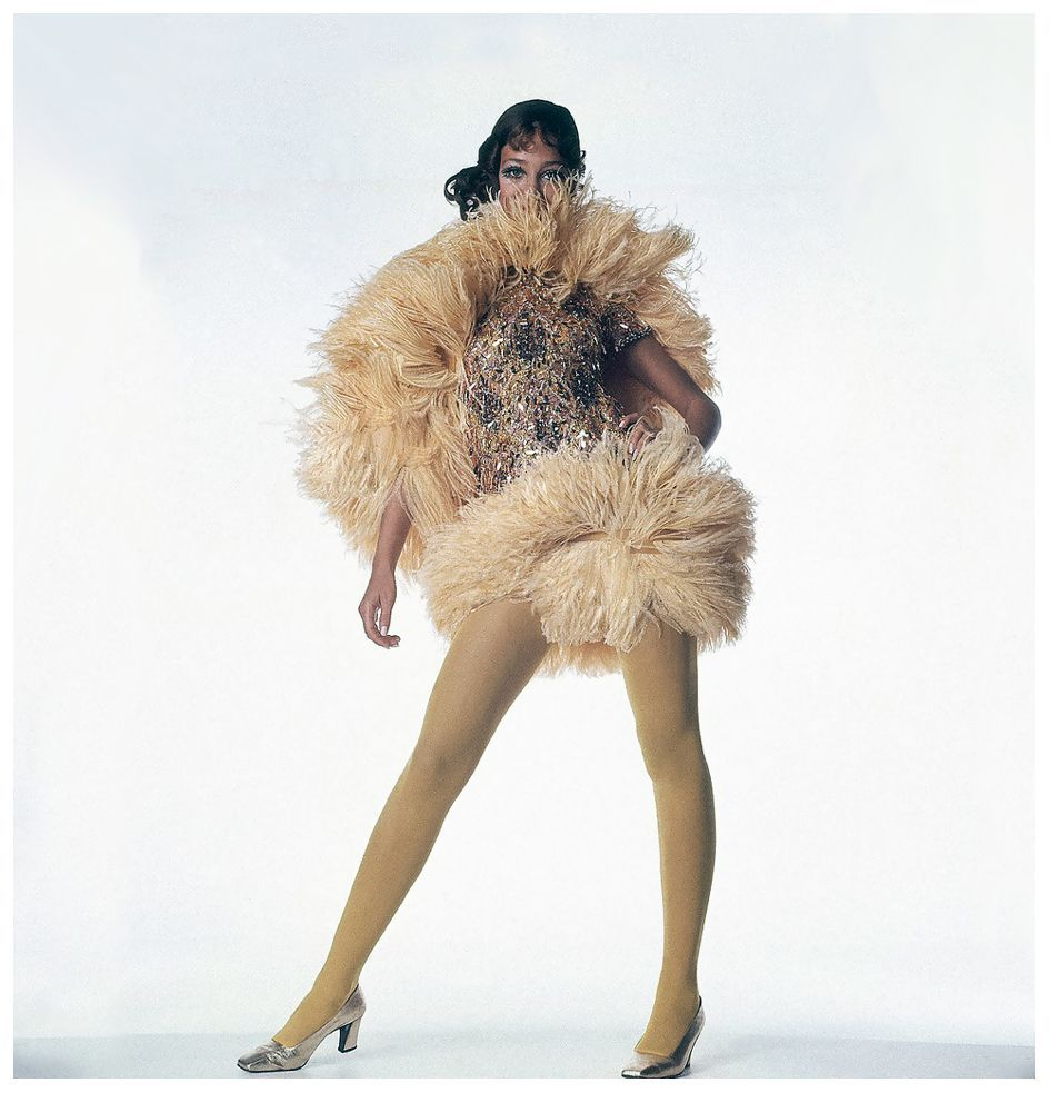 Marisa berenson is wearing short dance dress covered in pailettes