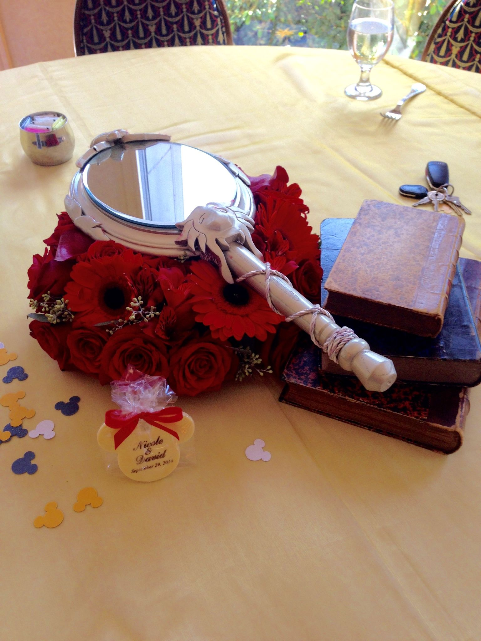 Disney beauty and the beast enchanted mirror and books for Disney themed wedding centerpieces