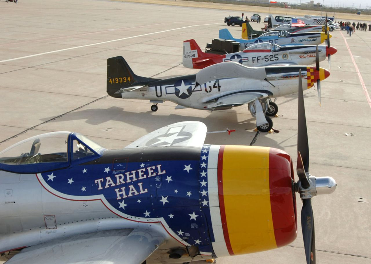 A P-47 Thunderbolt and several P-51 Mustangs rest on the Davis-Monthan Air Force Base, Ariz., ramp March 4 after a busy few days at the 2007 Heritage Conference there. The conference provided an opportunity for Air Combat Command demonstration pilots to train together with modern and historic military aircraft in preparation for the upcoming air-show season. (U.S. Air Force photo/Staff Sgt. Lanie McNeal)