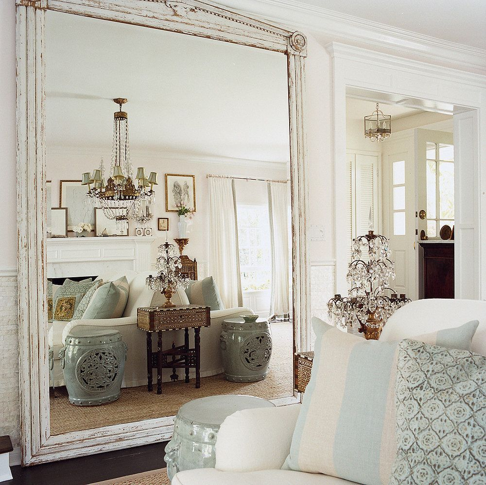 9 Ways To Fake Extra Square Footage With Mirrors Theeverygirl Small House Hacks Living Room Mirrors Home