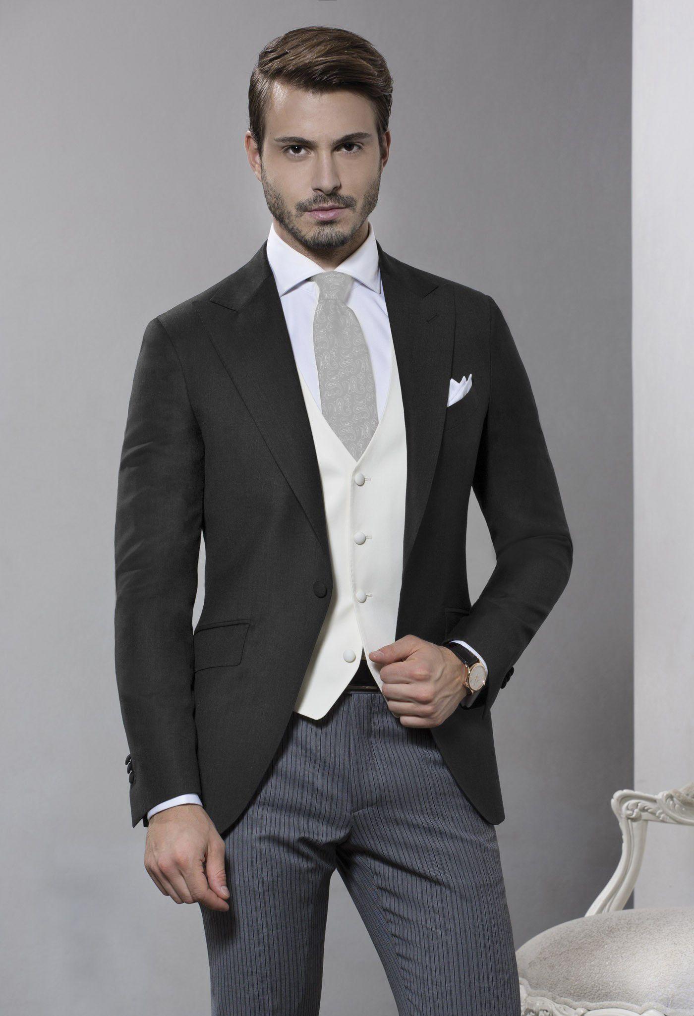 the groom, groomsmen, fathers. Coat is dark grey, vest is cream ...