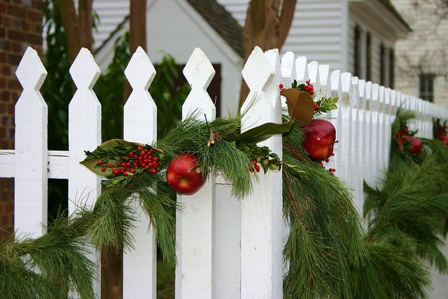 white picket fence decorated for christmas in colonial williamsburg - Christmas Fence Decorations