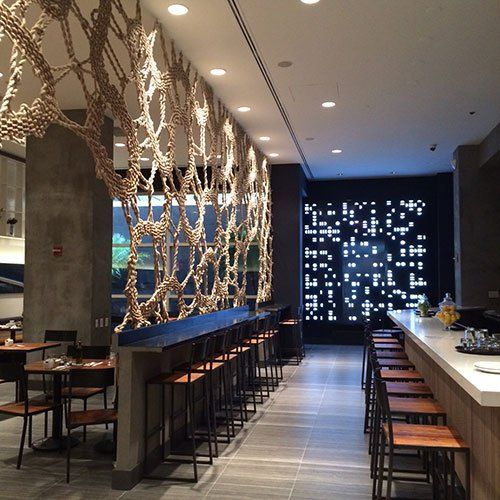 Rope Screen That Acts As Room Divider Between Bar And Dining Interior Design For STIX