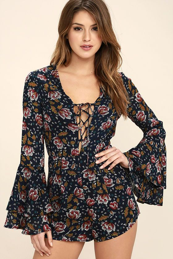 00c78d1f6b9 The Perennial Favorite Navy Blue Floral Print Long Sleeve Romper is in our  rotation year round! Woven poly