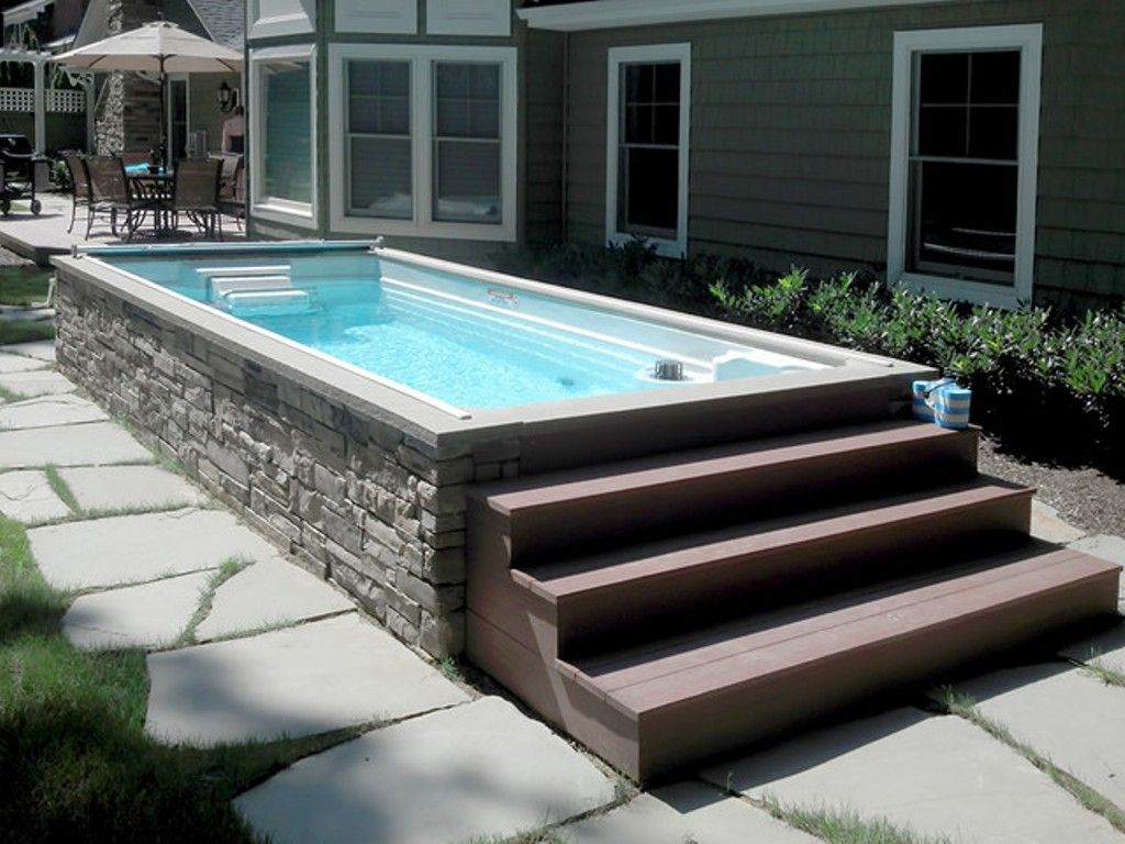 Long and narrow above ground pool with wooden stairs and - Above ground pool ideas on a budget ...