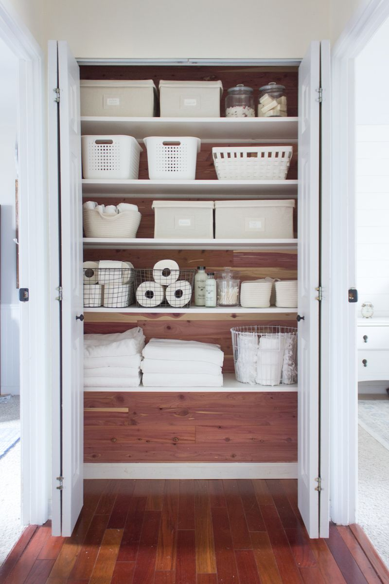 How I Completely Transformed A Linen Closet Using Cedar Planks And White Melamine Coated Shelves Bins Baskets Containers Creates Beautiful