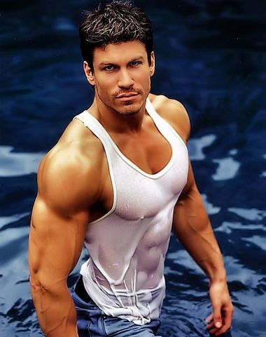 buffed soaked hunk wearing a wet tank top the wet tshirt