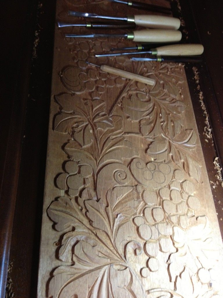 Woodcarving low relief on mahogany doors woodcarving