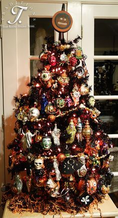 dont you love this 4 foot black tree full of halloween ornaments - Halloween Tree Decorations