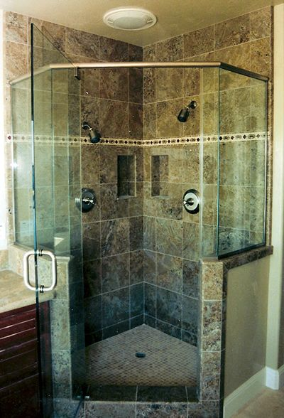 Corner Tile Shower Has Dual Shower Heads And Shampoo Cubbies Master Bathroom Shower Bathroom Remodel Shower Corner Shower