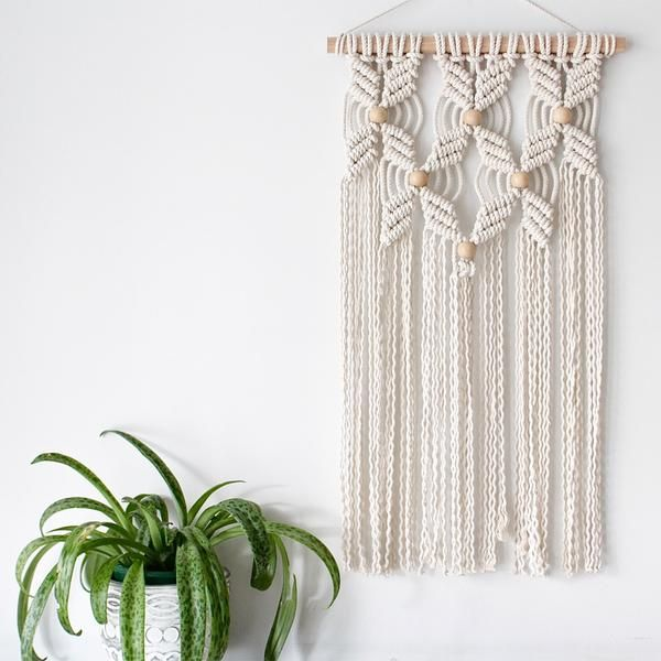 Beachy boho wall hanging. Made with 100% natural cotton. Size: 50cm wide x 60cm long