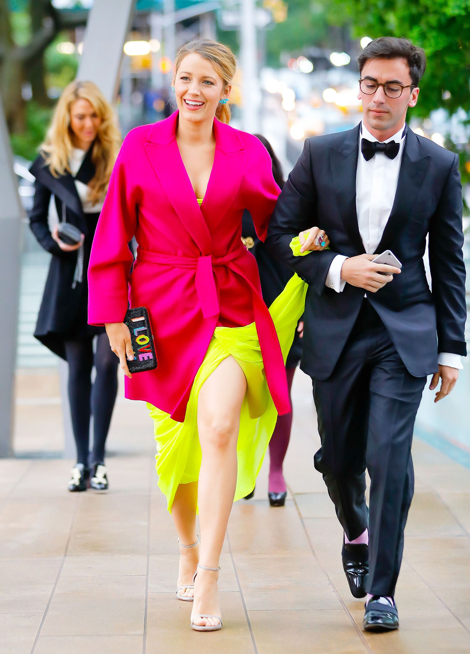 107dc8a209 Blake Lively in neon pink coat and neon yellow gown at American Ballet  Theater Gala Gotham GC Images