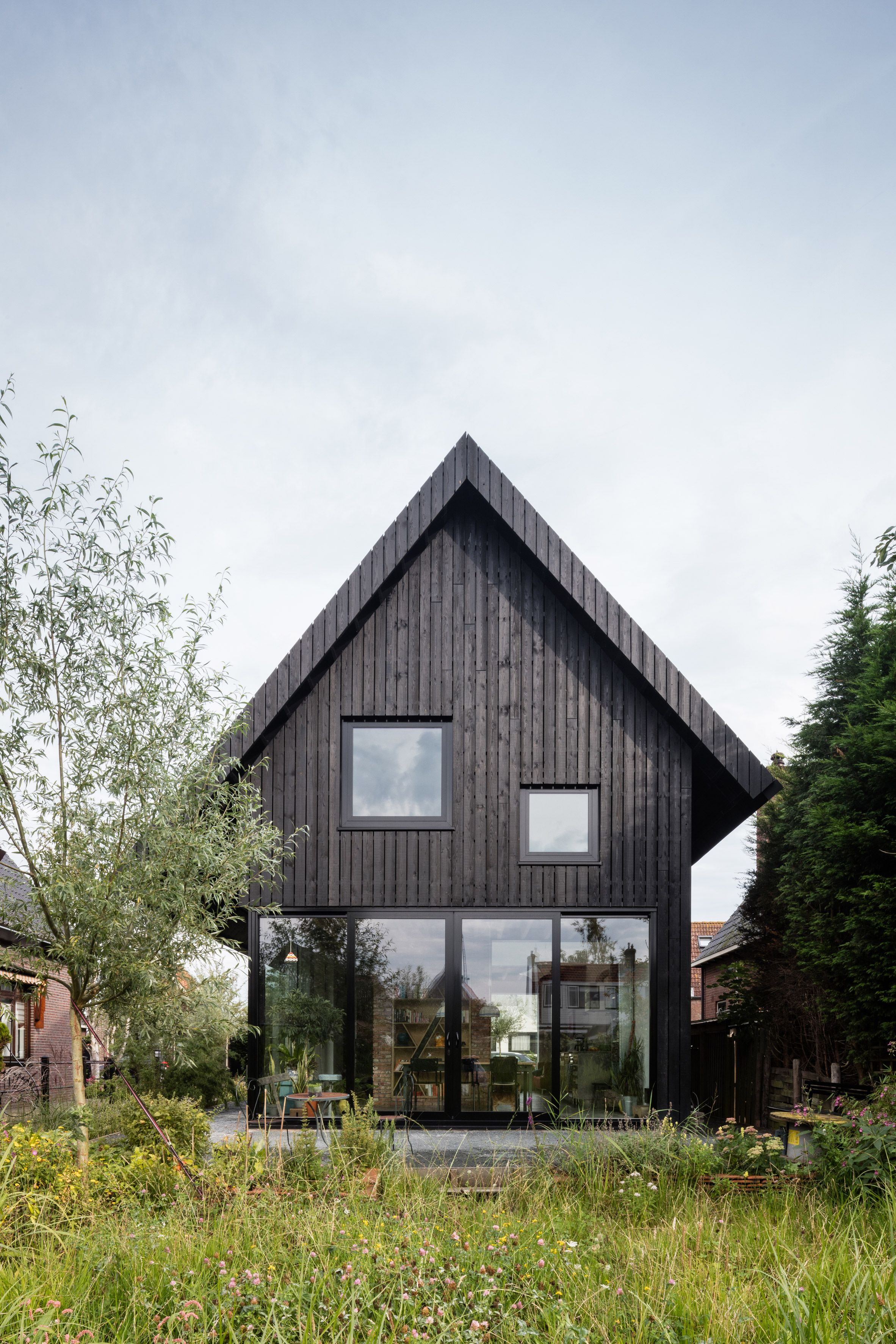 Dutch Architect Chris Collaris Has Completed A House In Amsterdam Clad Entirely In Blackened Timber And Wooden Cottage Cottage House Designs House In The Woods