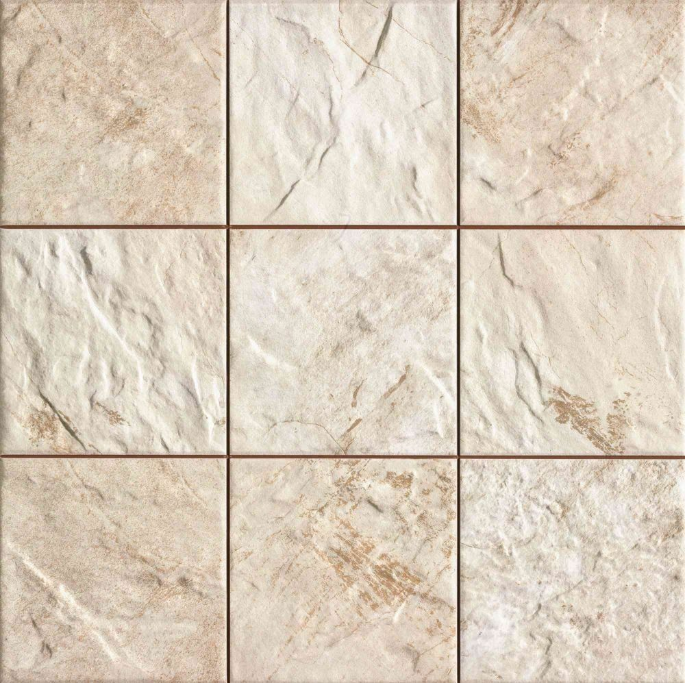 A riven textured finish wall tile with varied beige natural stone ...