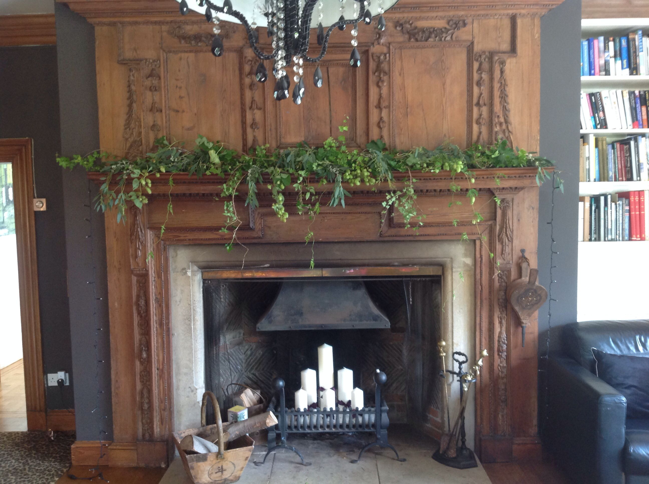 love this mixed foliage fireplace garland with the candle fire