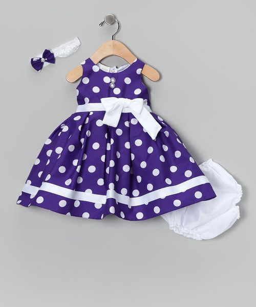 Complete with a lacy headband, silky-soft diaper cover and fancy frock that snaps in back, this charming ensemble makes getting dressed oh-so easy. Tulle in the lining gives this pretty polka dot piece extra pouf. Includes headband, dress and diaper cover100% polyesterMachine washMade ...