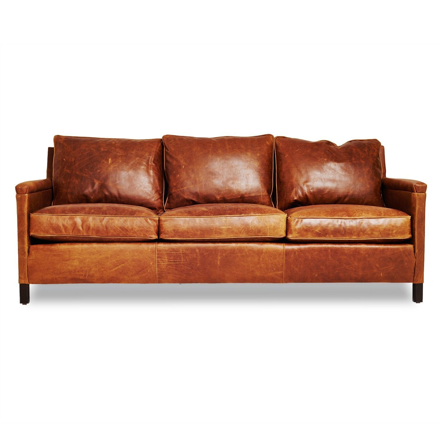 Beautiful brown leathe sofa and pillows with wooden frame