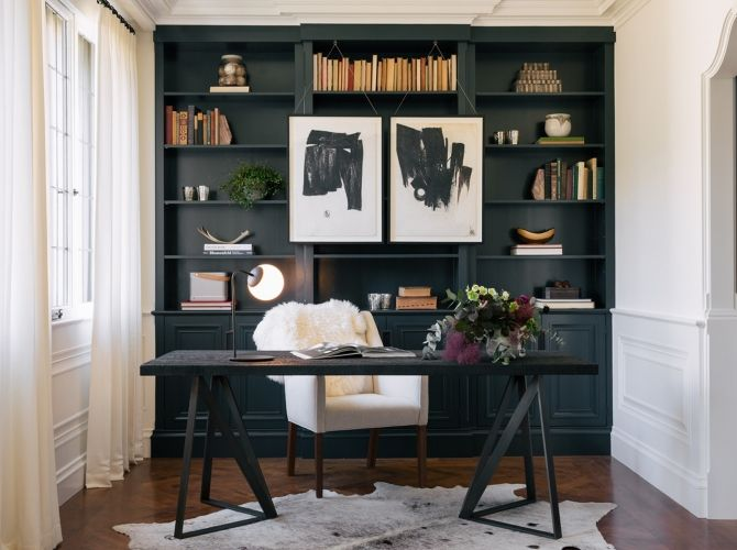Home Office With Navy Built In Shelving Cowhide Rug