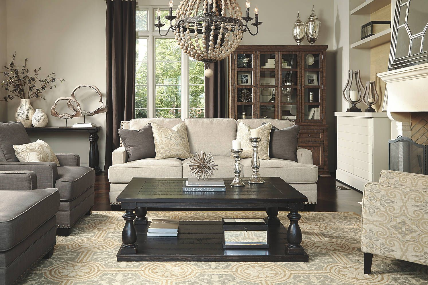 Elegance of the beige couch and patterned accent chair