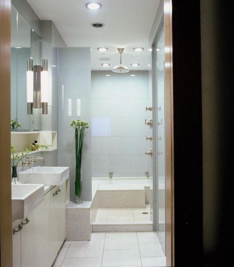 Modern Lighting In Elegant Bathroom With White Sink
