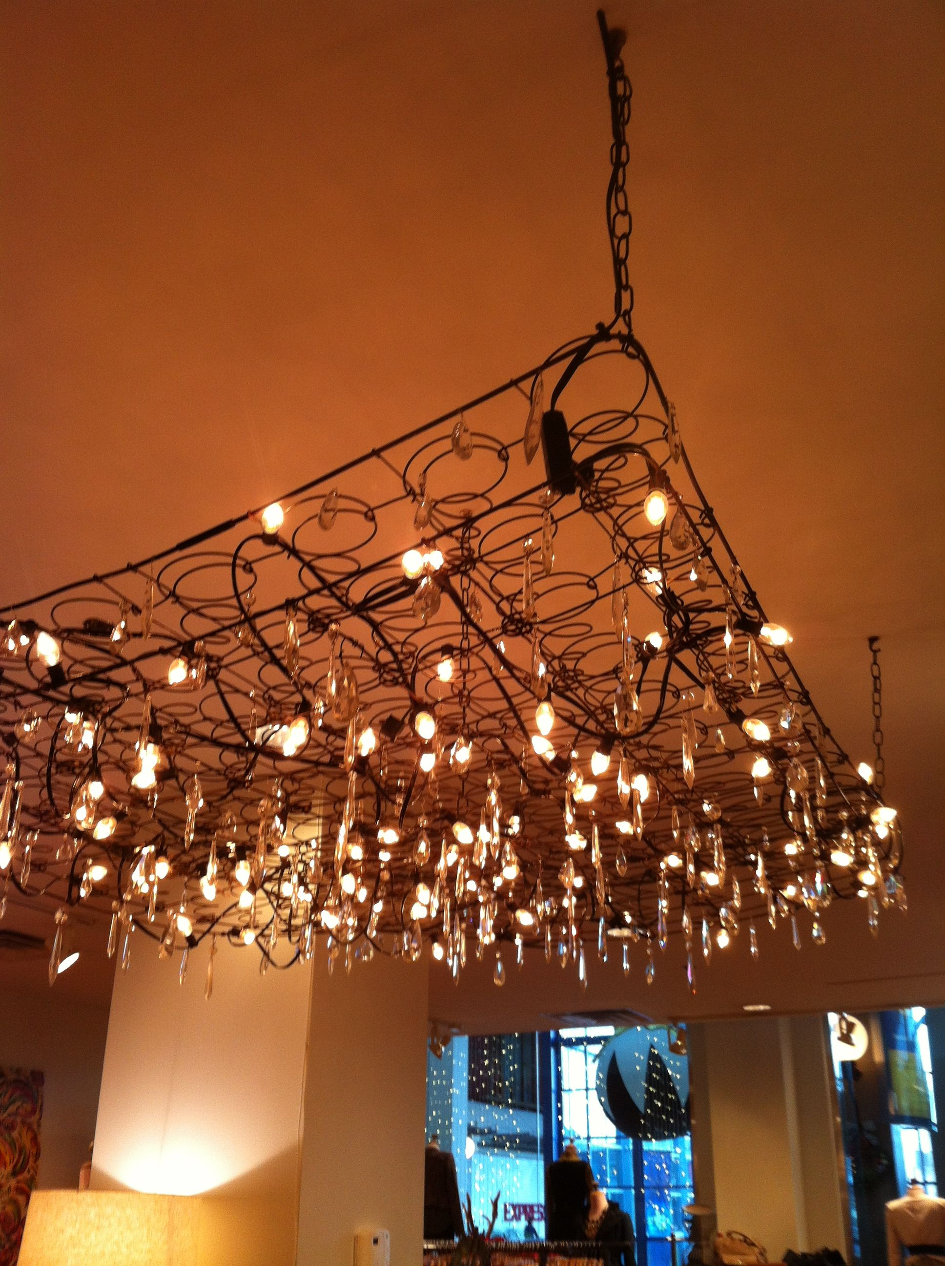 Bed spring chandelier. Love it in a loft space. Spring