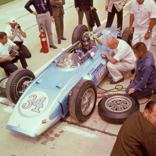Dan Gurney in Mickey Thompson's Buick stock block V8 powered 'Harvey Aluminium Special', Thompson in the dark shirt at right, Indy 1962. This engine, famously the brother of the F85 Olds, the block of which f