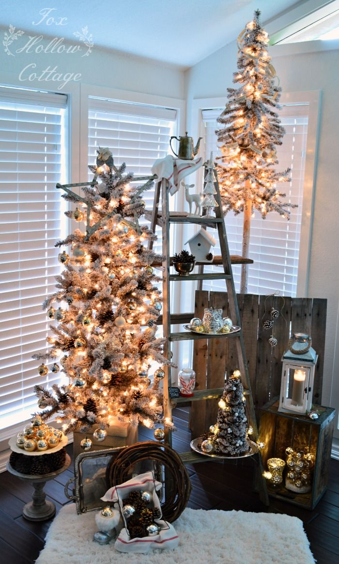 stack smaller christmas trees like these pre lit beauties from homegoods with things like old ladders and pallets throw in a vintage milk crate some