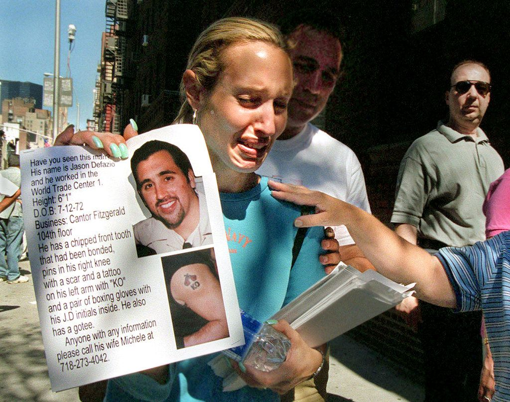9/11 ~ MICHELE DE FAZIO: sobbed as she held up a poster of