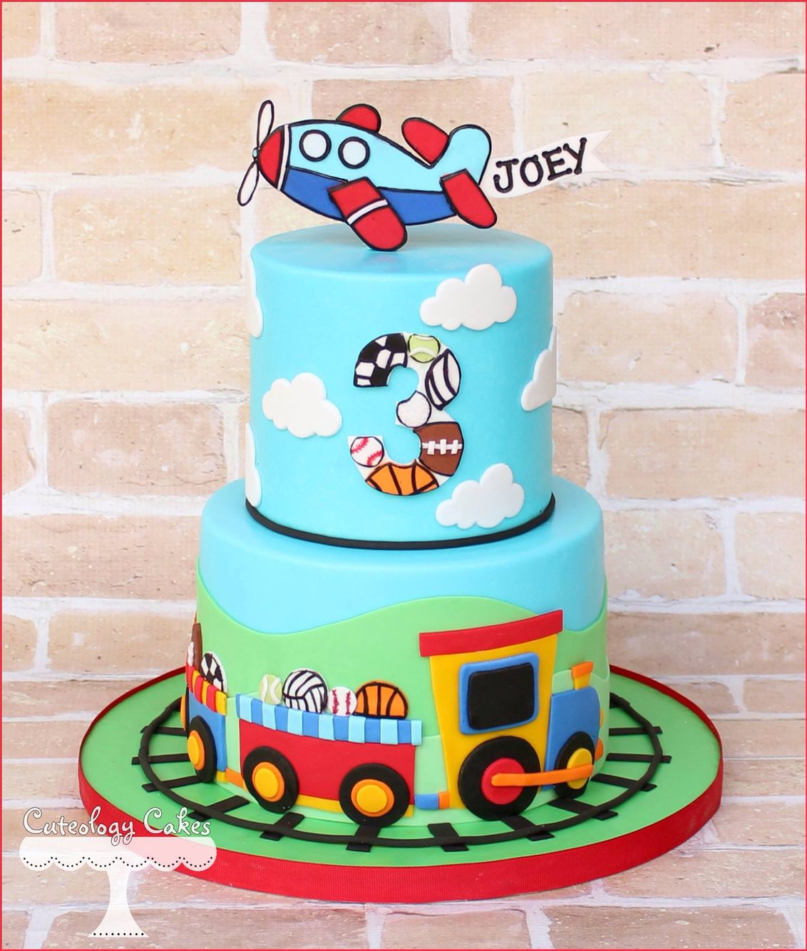 Boy sports, planes, and trains cake