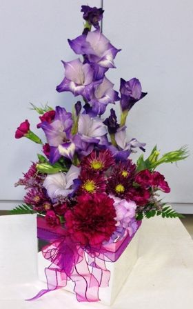 Hot Pink And Purple Flowers In A Mirrored Cube Vase From Seasonal