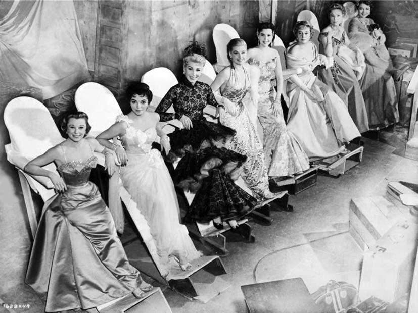 The stars of The Opposite Sex on their leaning boards: June Allyson, Joan Collins, Dolores Gray, Ann Sheridan, Ann Miller, Joan Blondell, Agnes Moorehead and Barbara Jo Allen.