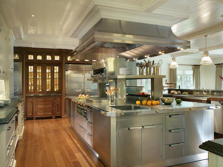 Craftsman Style Kitchen Features Large Kitchen Hood Over An