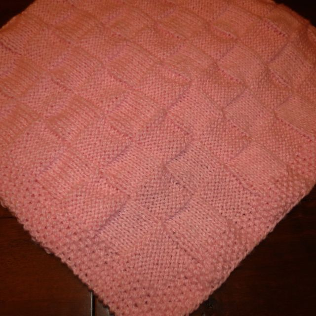 CHARMING BASKETWEAVE BABY BLANKET WITH SEED STITCH BORDER KNITTING PATTERN