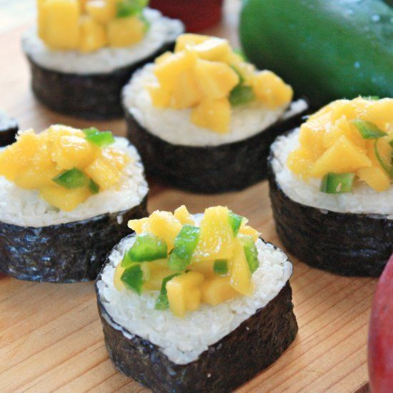 Latin Fusion Sushi with Cream Cheese Avocado and Mango Jalapeño Topping A healthy vegetarian sushi