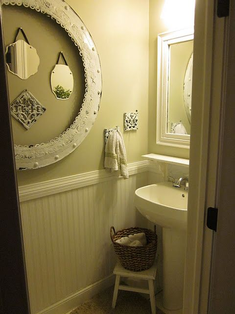 Ideas for 1/2 bath. Smaller mirrors inside of a larger frame, basket with extra hand towels, white theme.
