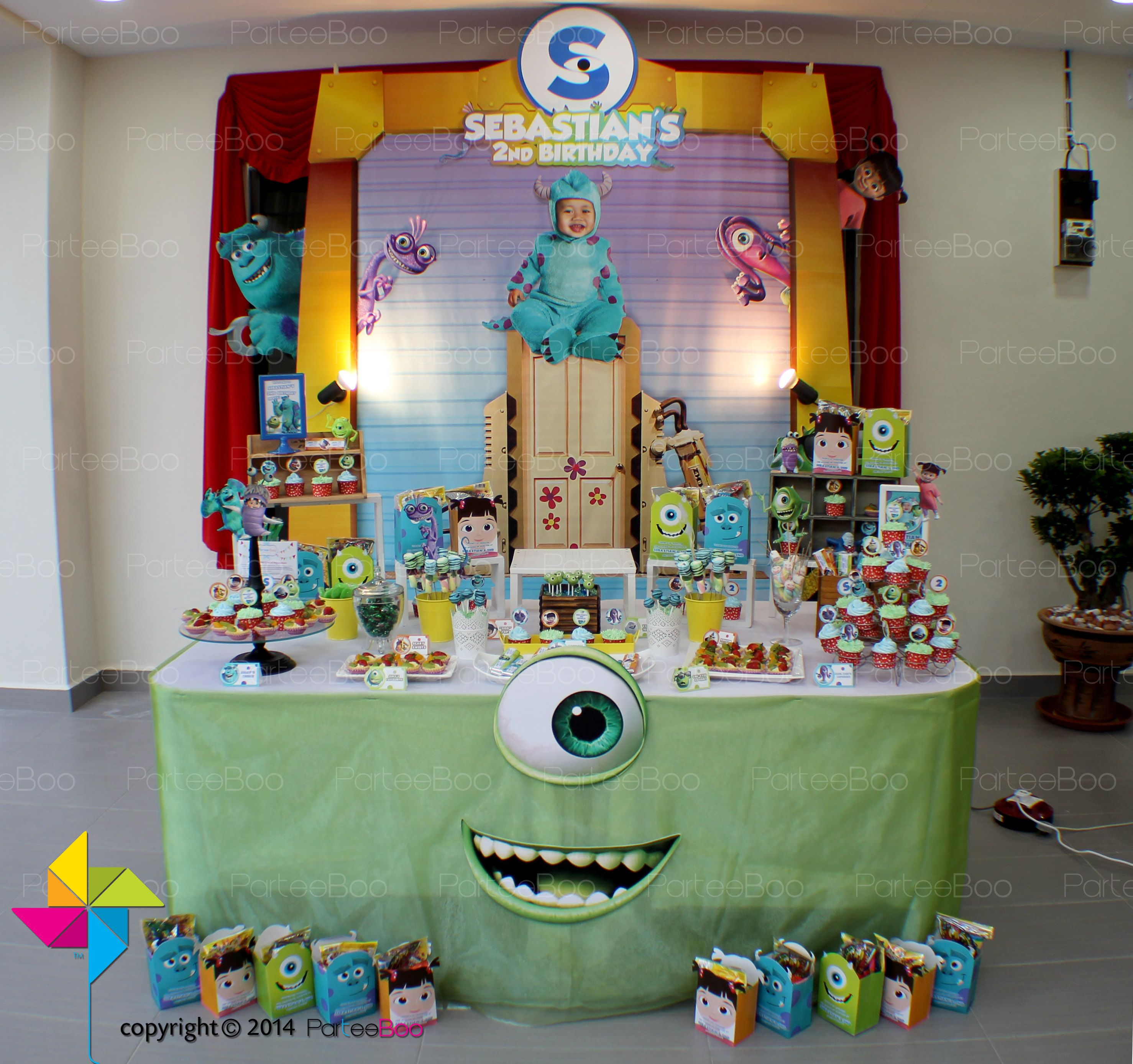 A Monster Inc Themed Birthday Party This Is The Backdrop Candy Buffet And Goodie Boxes Design A Monster 1st Birthdays Monster Inc Birthday Monster Inc Party