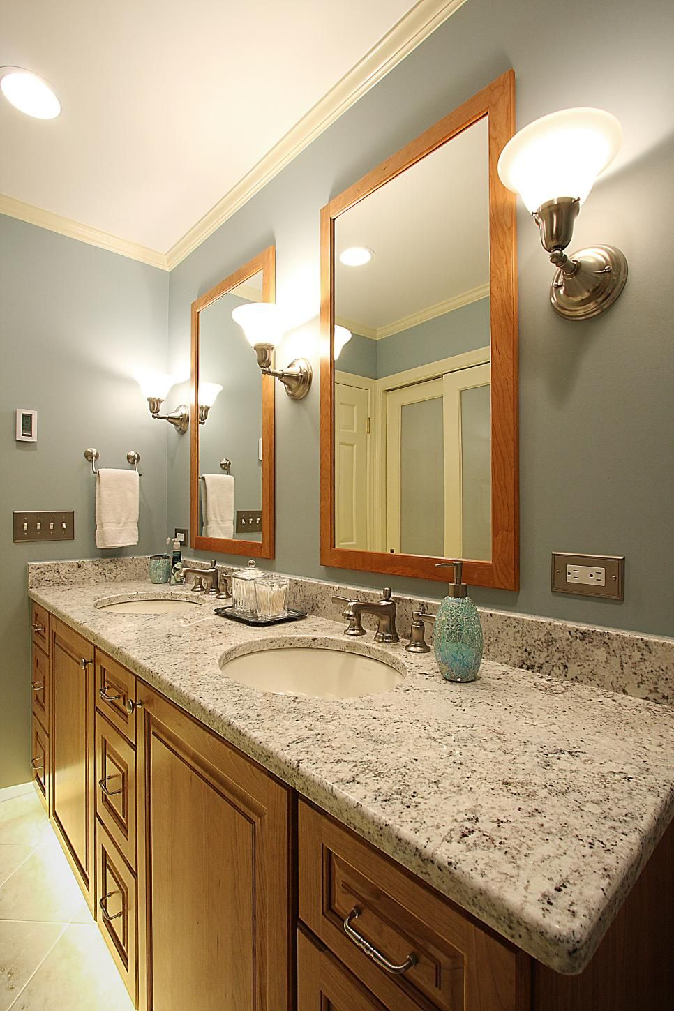 This Blue Gray Bathroom Features A Double Sink Vanity With Natural