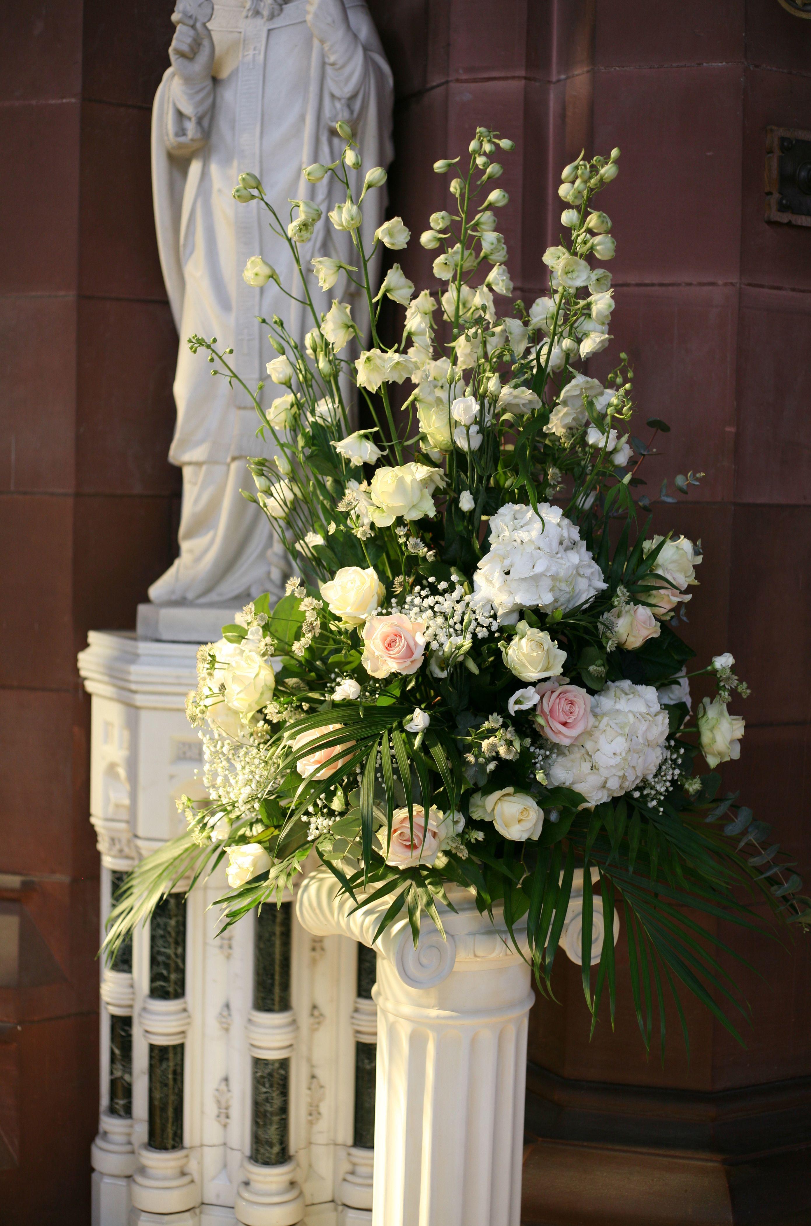 Church pedestal arrangement with white delphiniums for Flower arrangements with delphinium
