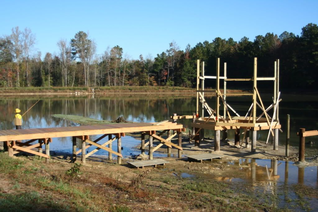 amazing pond pier designs #3: Gazibo and boardwalk construction over pond.