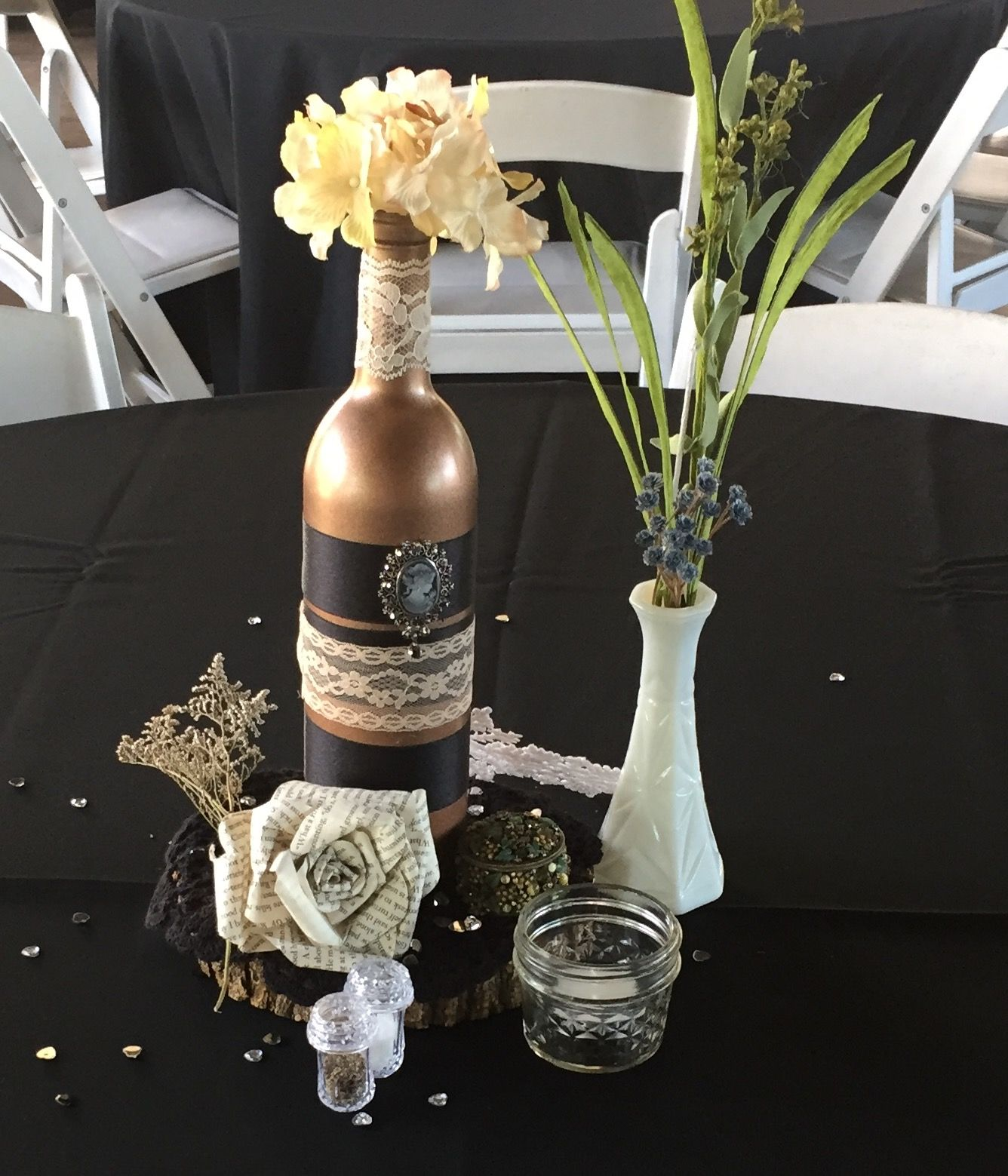 Vintage eclectic centerpiece #5, made with A copper colored decorated wine  bottle, a