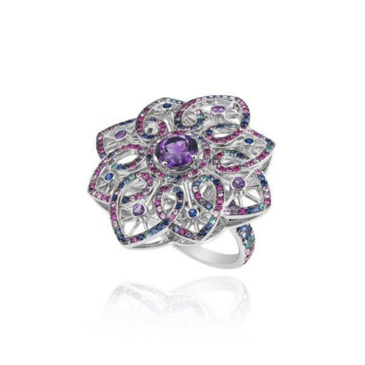 CANNES Chopard Jewels... Not affordable for everyday people, but still gorgeous and radiates summer colors!