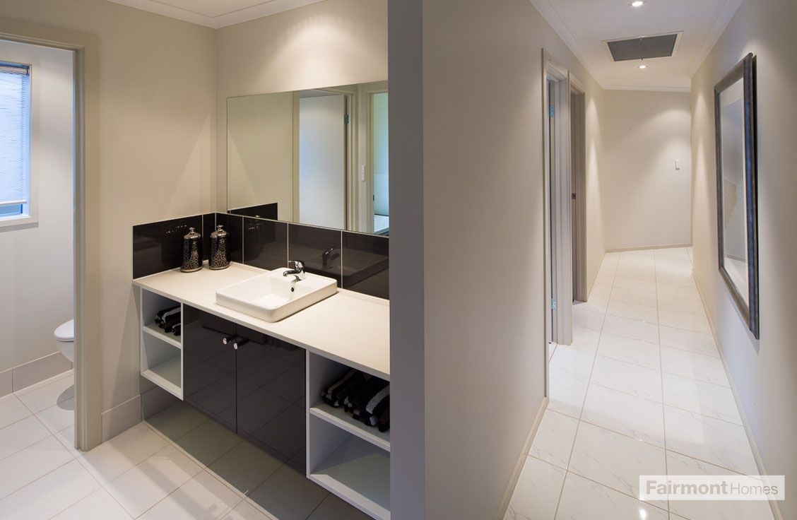 Fairmont Homes: A view of the 3-Way bathroom of the ...