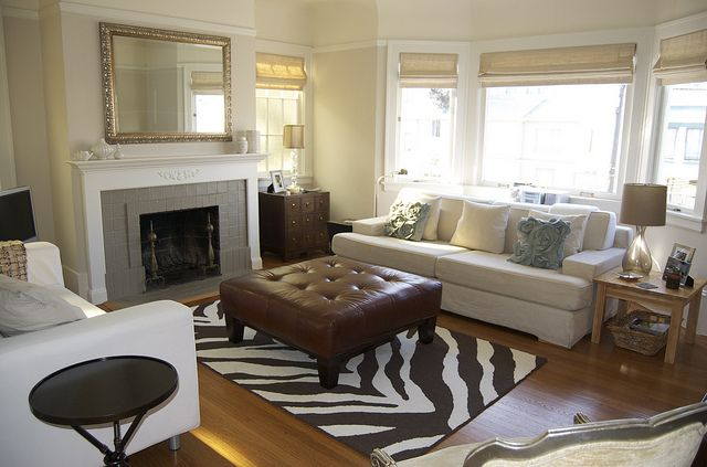 Maybe something like this but with mushroom brown walls, black leather furniture, and lime-ish green accents. Love this rug too!