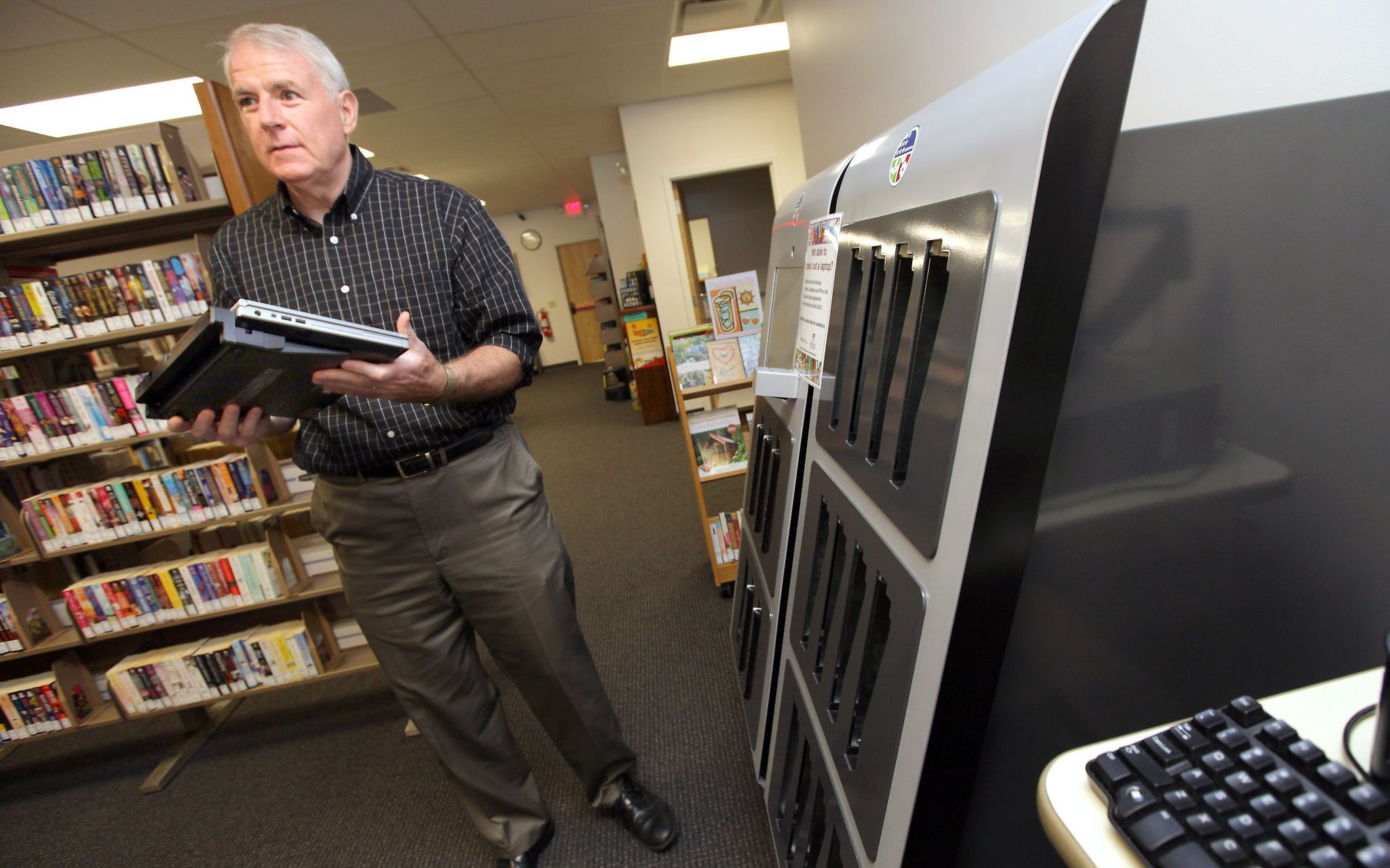 Mayor Tom Barrett says he's 'doubling down' on the city's branch library system, spending $22.4 million over the next few years.