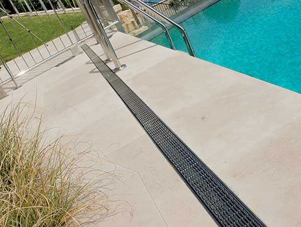 Stylish Linear Drainage Around The Pool Outdoor Solutions Outdoor Patios