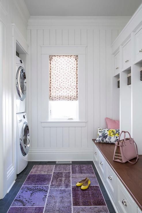 Chic Mudroom Features Walls Clad In Beadboard Trim Lined With