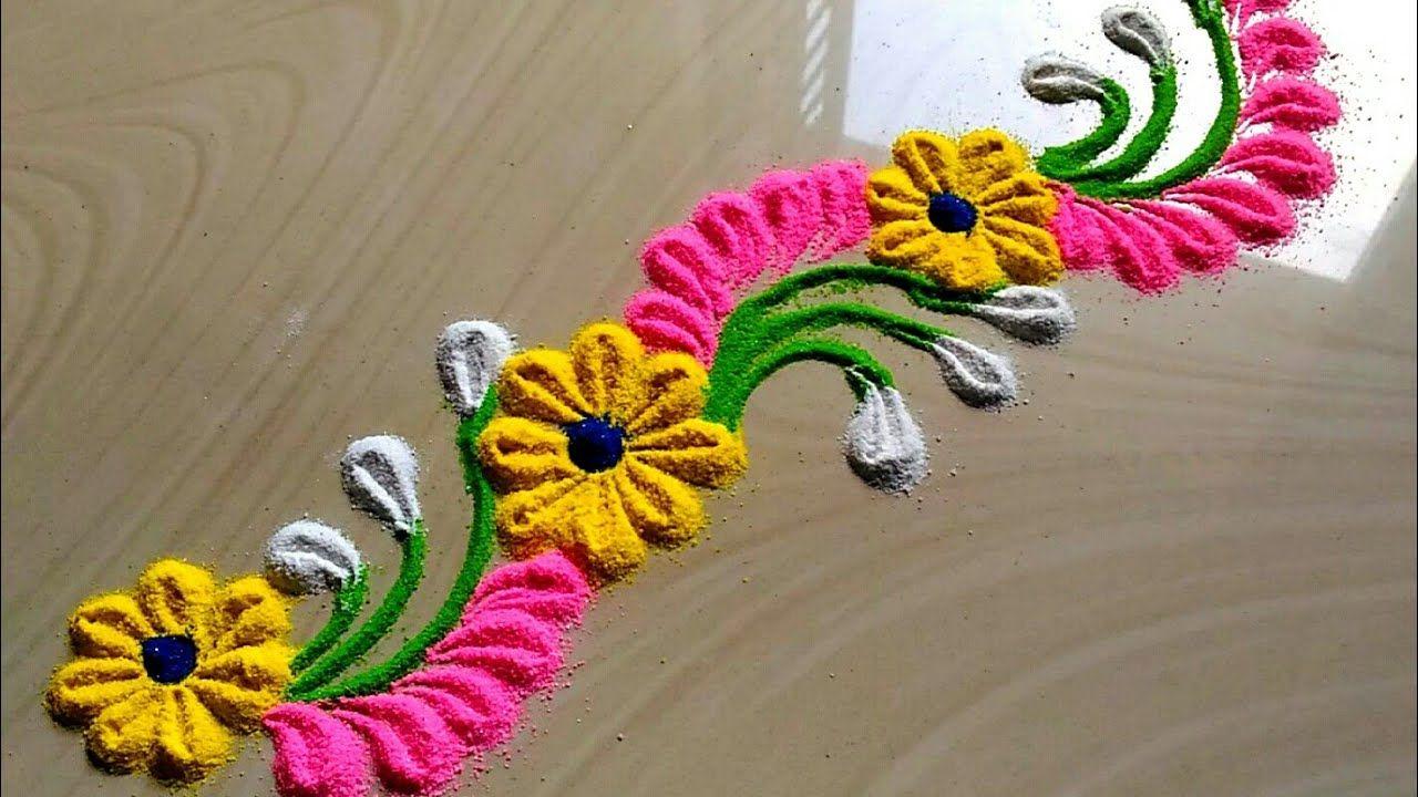 Very innovative BORDER rangoli designs with flowers by jyoti