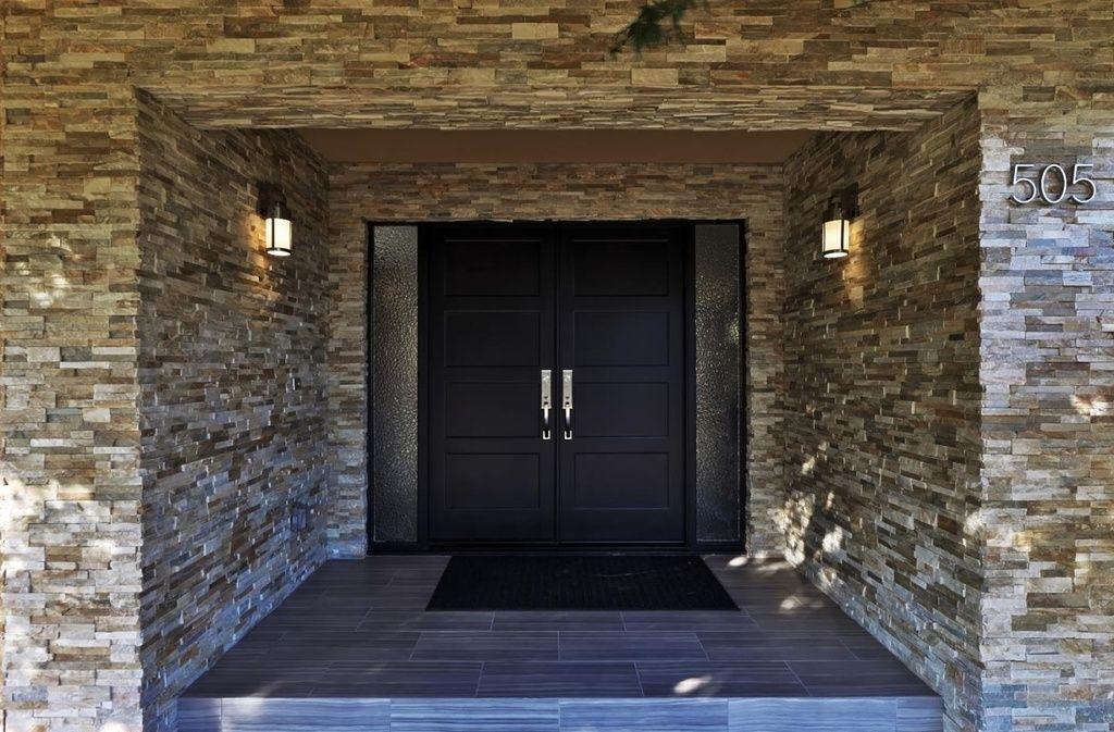 Eclectic Front Door with exterior tile floors in