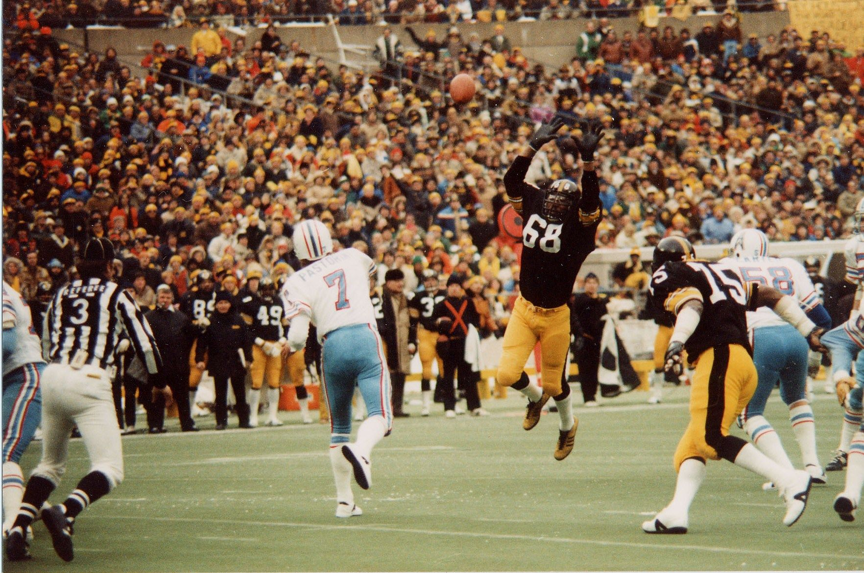 Dan pastorini fires into the steelers defense during the