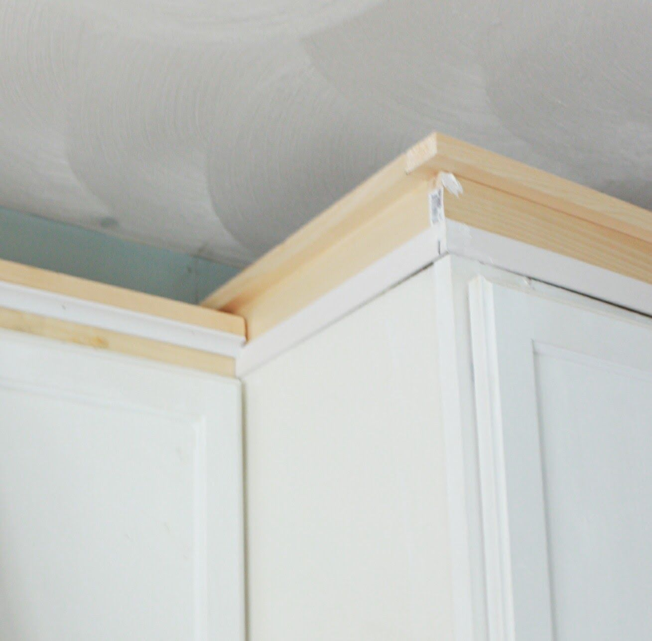 My Diy Kitchen Cabinet Crown Molding How To Fake The Look Without The Fuss Made By Carli Kitchen Cabinet Crown Molding Crown Moulding Kitchen Cabinets Kitchen Cabinet Molding